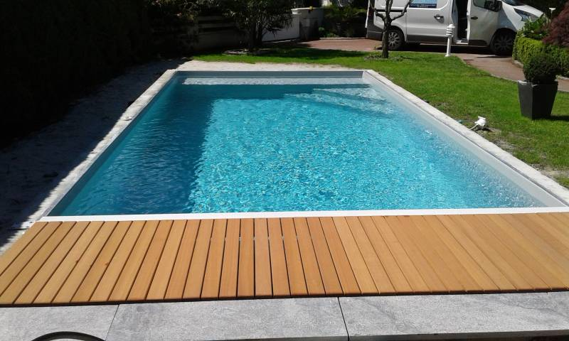 R alisation d 39 une piscine traditionnelle avec volet for Piscine merignac